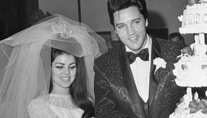 Elvis Presley and Priscilla Ann Beaulieu, 21, cut the cake at the Las Vegas reception following their wedding, 5/1. Presley, 32, met his wife when he was in Germany in the Army in 1959. The marriage ends his reign as one of the most eligible bachelors in show business.