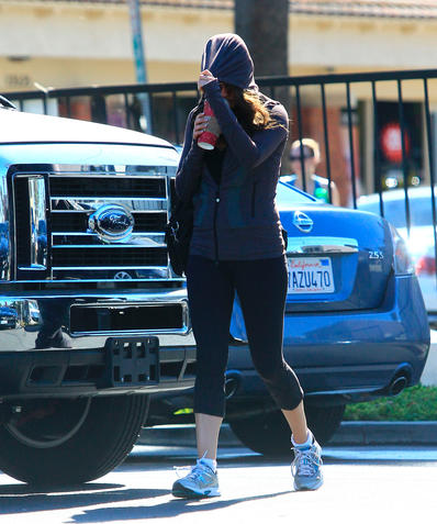 Mila Kunis Gets Camera Shy On Coffee Run