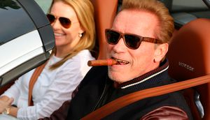 Arnold Schwarzenegger Leaves Lunch With A Cigar & His Bugatti