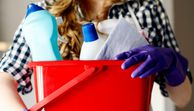 Close-up of woman's hands holding bucket full of cleaners