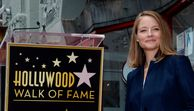 Actress Jodie Foster R poses for photographers during an unveiling ceremony honoring Foster with t